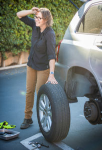 Basic Auto Care instructor Sarah Lyon changing a tire